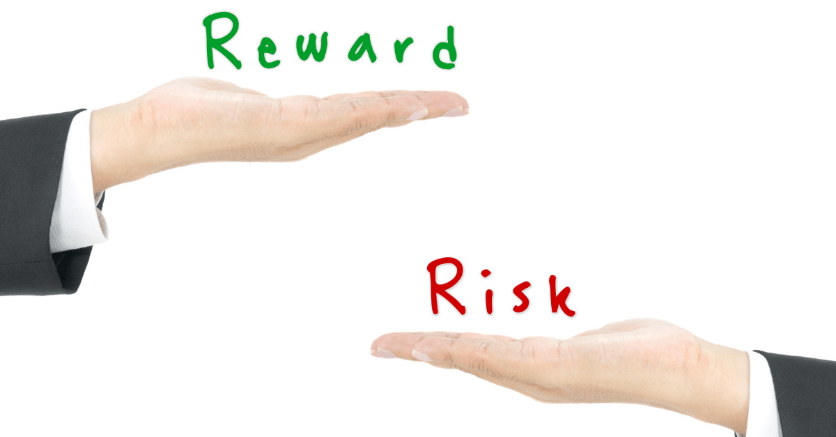 two hands with one hand labelled reward and the other risk