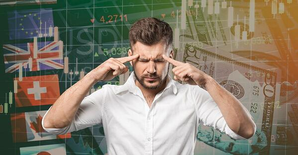 man thinking too hard to develop a winning trading mindset