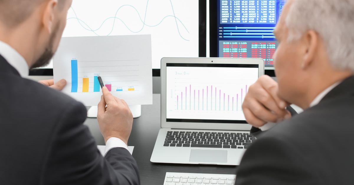 a trader explaining the charts to a client