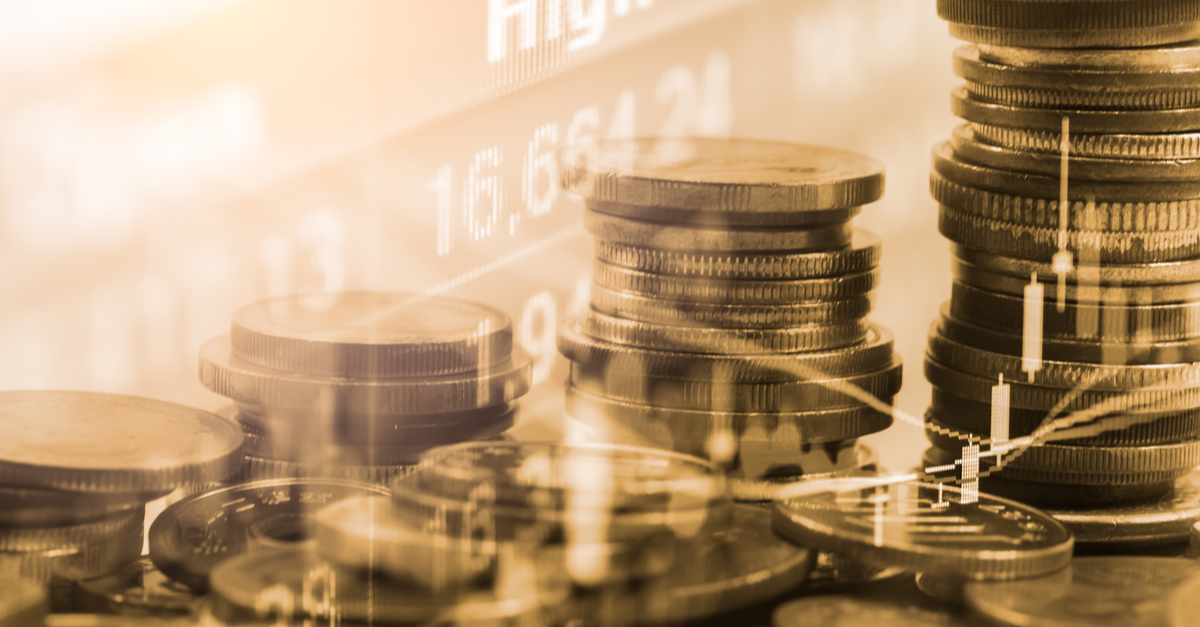 Stack of coins with the forex trading graph on the background