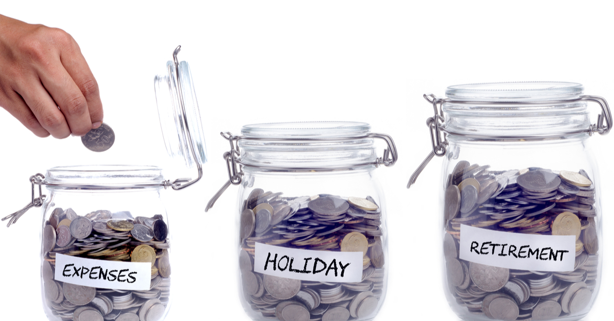 Three coin jars labelled expenses, holiday and retirement