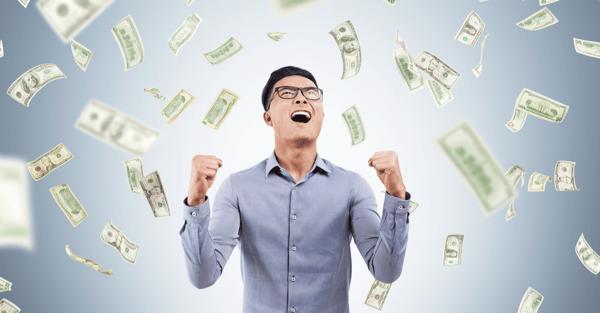dollar_bills_raining_on_an_excited_man